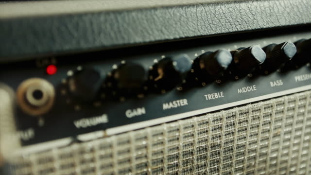 amplifier for electric guitar in a music studio - amplifier stock videos & royalty-free footage