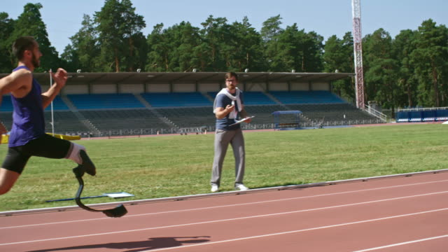 Amputee athlete sprinting on track
