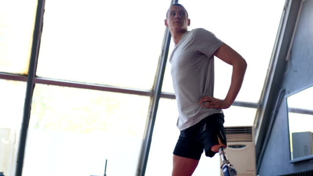 amputee athlete stretching before training - adversity stock videos & royalty-free footage