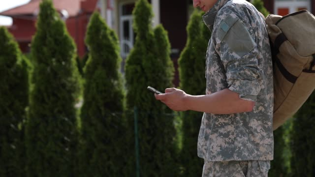amputee soldier text messaging to his family on his way home - wireless technology stock videos & royalty-free footage
