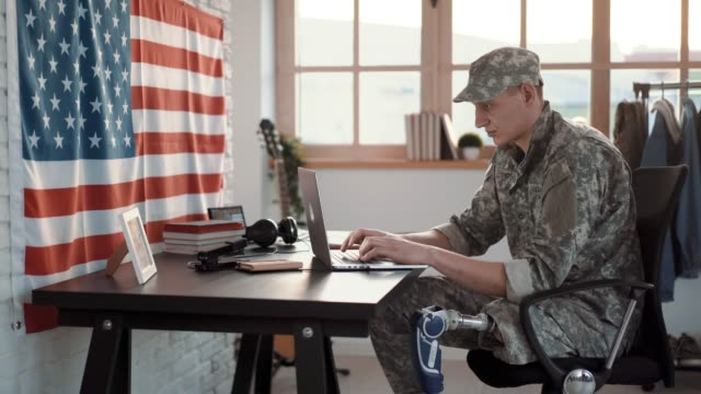 amputee soldier working at office - military uniform stock videos & royalty-free footage