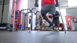 Various shots of Michael Ishiguzo training in gym with instructor    Stock  Footage Video