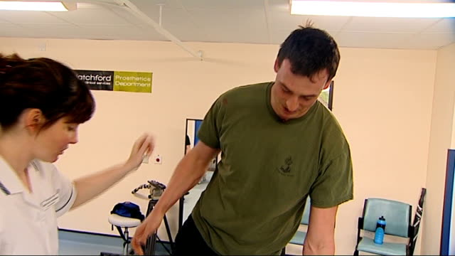 Amputees to be offered bionic limbs ENGLAND Surrey Leatherhead Headley Court INT Prosthetic legs TILT UP Captain Nick Beighton during physiotherapy...