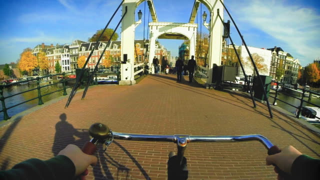 amsterdam by bike - bridge over the amstel - amsterdam stock videos & royalty-free footage