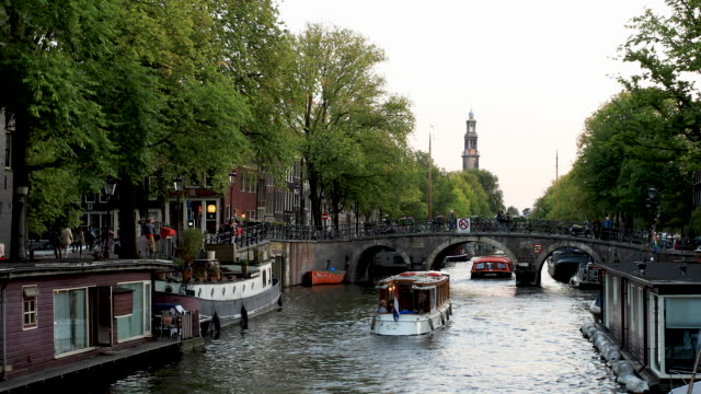 amsterdam canal 4k video with boat traffic on prinsengracht - canal stock videos & royalty-free footage