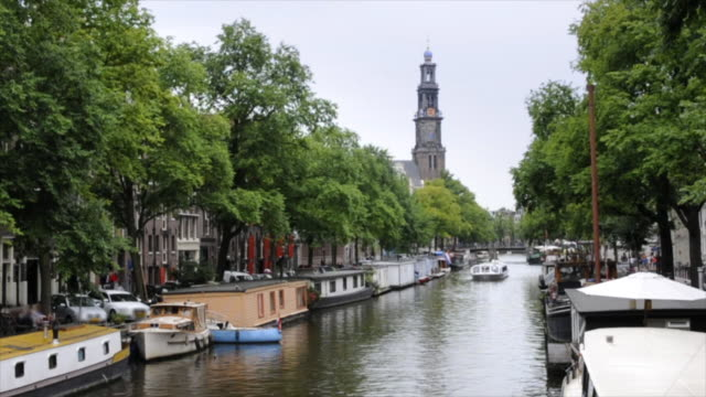 amsterdam canal boat (timelapse) - canal stock videos & royalty-free footage