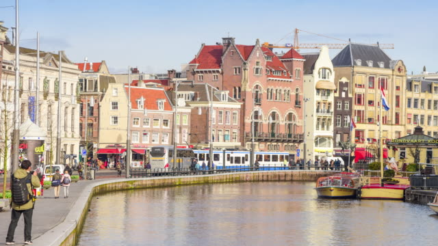 amsterdam canal, north holland, kingdom of the netherlands. state museum tower view. street and amsterdam canal, bicycles and cyclists, houseboats, living boats. - history stock videos & royalty-free footage