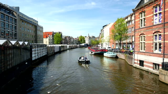 amsterdam canal with floating market - moat stock videos and b-roll footage