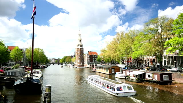 amsterdam canal  with hosueboats and ships - canal stock videos & royalty-free footage