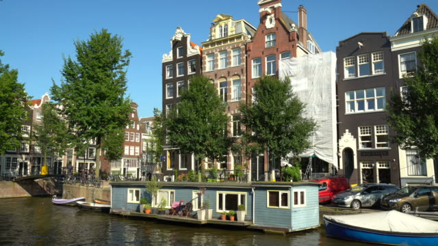 amsterdam canal with houseboats - canal stock videos & royalty-free footage
