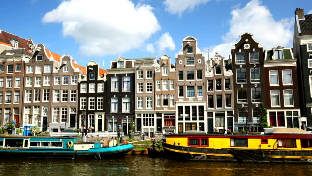 amsterdam canal with houses, panning - canal stock videos & royalty-free footage