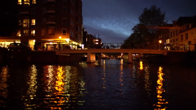amsterdam canals at night - boat point of view stock videos & royalty-free footage