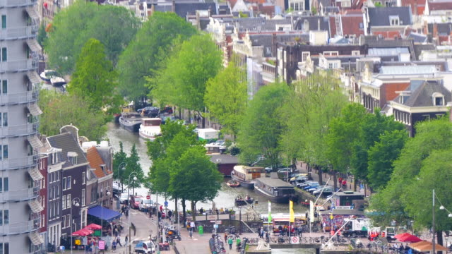 amsterdam canals birds eye view of much activity of tourists - canal stock videos & royalty-free footage