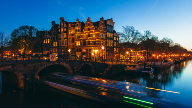 amsterdam canals by night time lapse - dusk stock videos & royalty-free footage