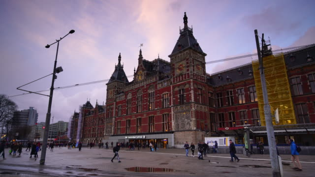 amsterdam central train station in the netherlands - canal stock videos & royalty-free footage