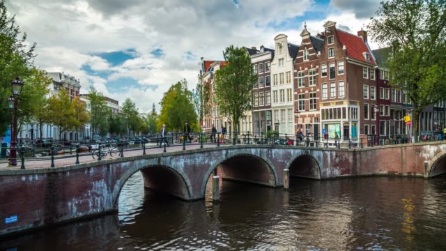 amsterdam cityscape with canal and bridge - canal stock videos & royalty-free footage