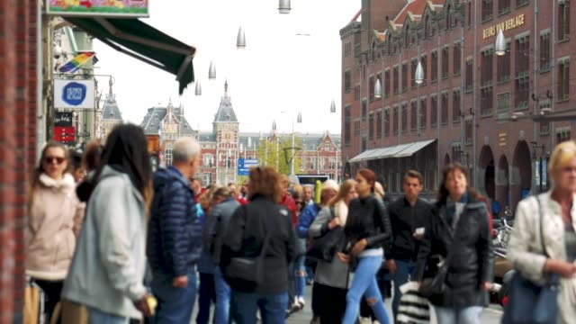 amsterdam damrak & central station - netherlands stock videos & royalty-free footage