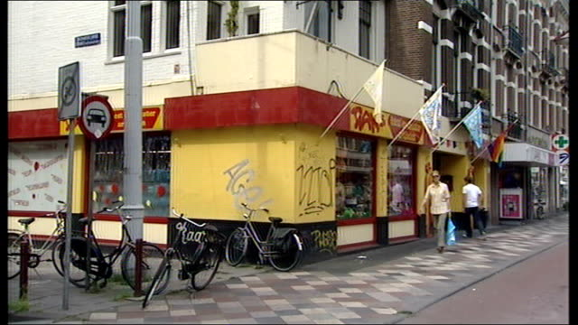 amsterdam ext dams shop - olanda settentrionale video stock e b–roll