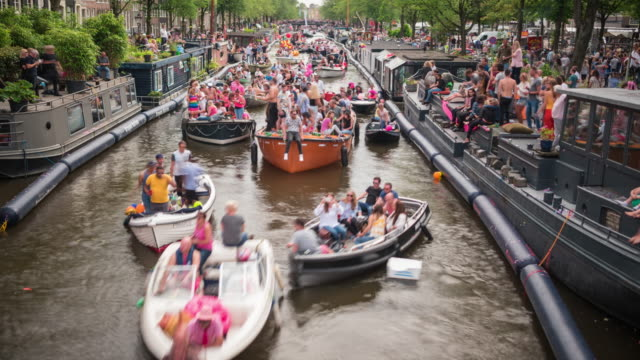 4k: amsterdam gay pride time lapse - parade stock videos & royalty-free footage