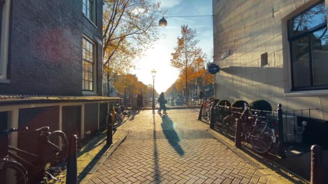 amsterdam in golden sun - high street stock videos & royalty-free footage