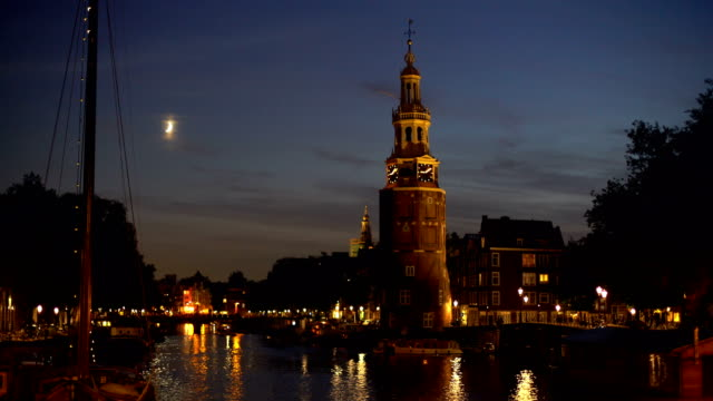 amsterdam skyline with canal and old tower - dutch culture stock videos and b-roll footage