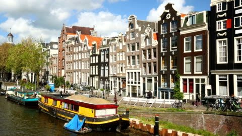 amsterdam skyline with canal, panning - amsterdam stock videos & royalty-free footage