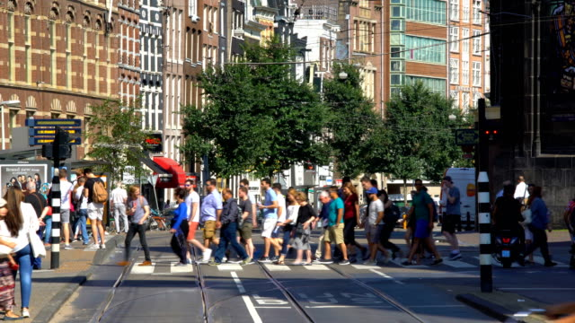 amsterdam street with pedestrians - high street stock videos & royalty-free footage