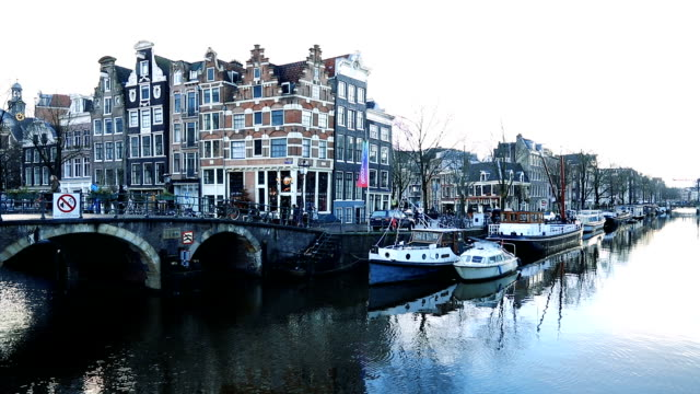 amsterdam tranquil canal scene, netherlands - netherlands stock videos & royalty-free footage