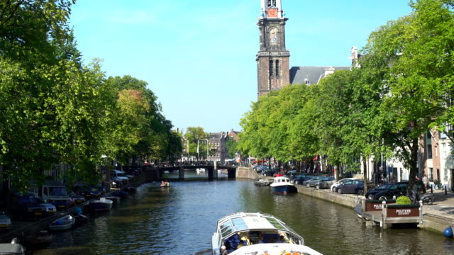 amsterdam westerkerk with canal, panning - canal stock videos & royalty-free footage