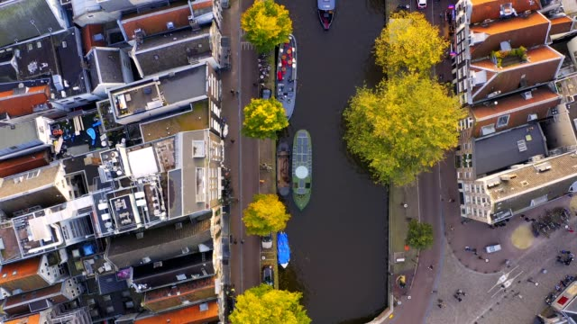 amsterdam/netherlands-oct 31 2019: uhd 4k drone arrial view of of prinsengracht canal the famous spot with old tradition house and church in amsterdam, the netherlands - canal stock videos & royalty-free footage
