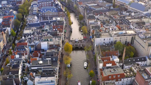amsterdam/netherlands-oct 31 2019: uhd 4k drone arrial view of of prinsengracht canal the famous spot with old tradition house and church in amsterdam, the netherlands - northern europe stock videos & royalty-free footage