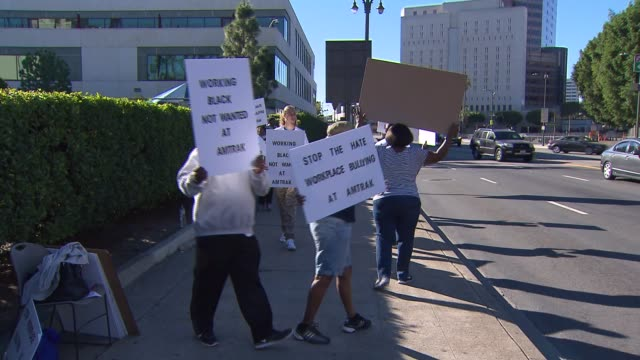 ktla amtrak discrimination protest on november 2015 a group of workers claim amtrak has had a history of discrimination protestors took to the... - union station los angeles stock videos & royalty-free footage