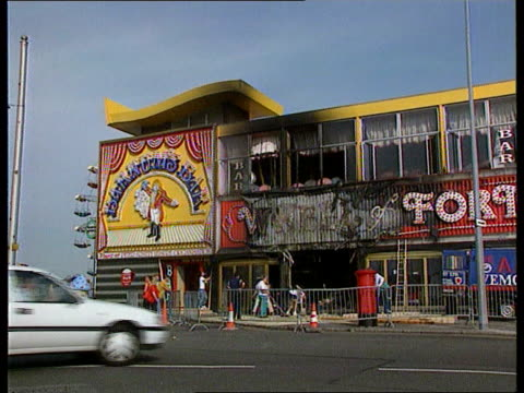 amusement arcade fire; amusement arcade fire; england gv partly burnt amusement arcade l-r more ditto portsmouth more of amusement arcade - arcade fire stock videos & royalty-free footage
