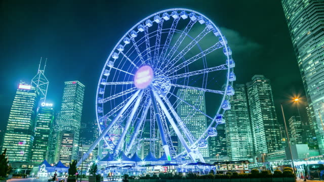 amusement fun park in city at night with ferris wheel - international landmark stock videos & royalty-free footage
