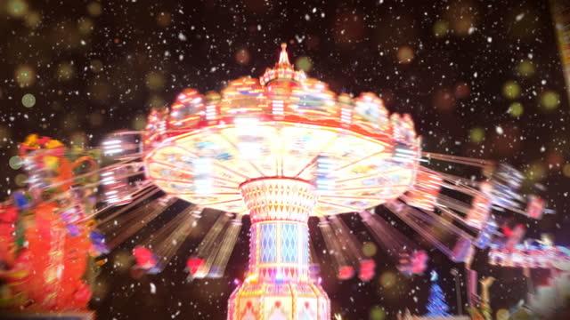 vidéos et rushes de amusement park at a snowy night, vidéo - format hd