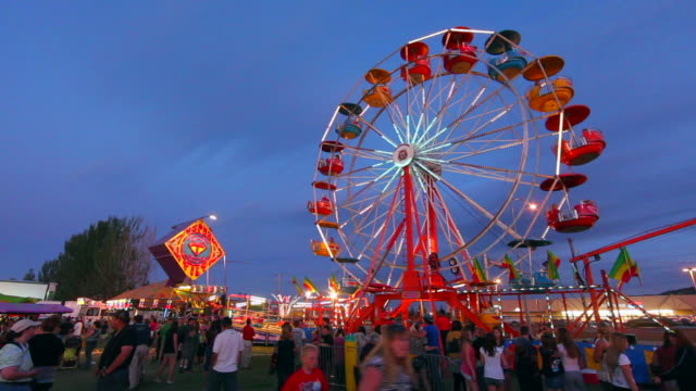 WS Amusement park at dusk at Northwest Montana Fair in Kalispell / Montana, USA