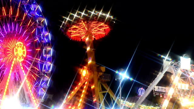 amusement park at night - fairground stock videos and b-roll footage
