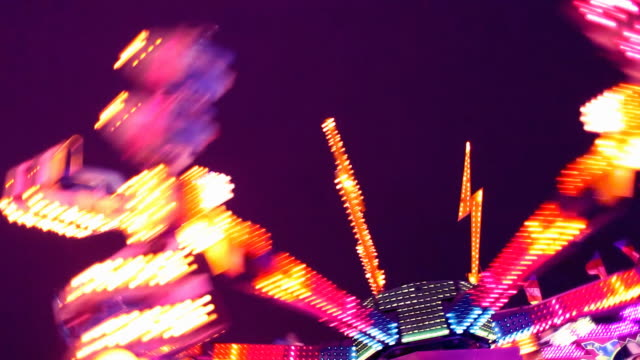 amusement park carnival ride at night - fairground stock videos and b-roll footage