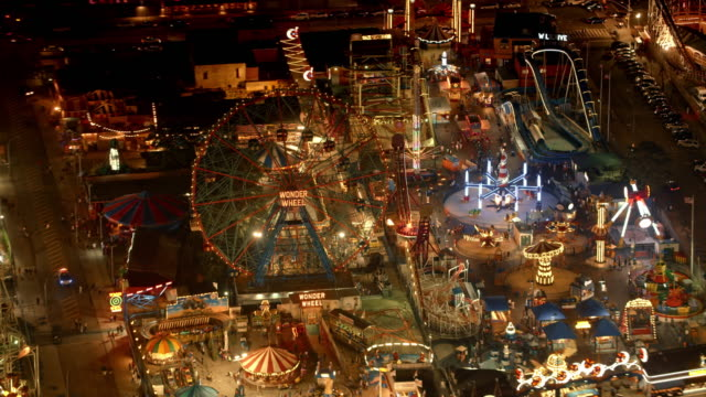 aerial amusement park on coney island at night - coney island brooklyn stock videos & royalty-free footage
