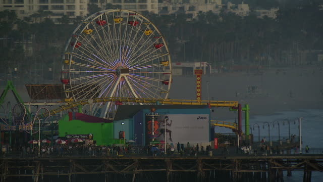 amusement park on santa monica pier - santa monica pier stock videos & royalty-free footage