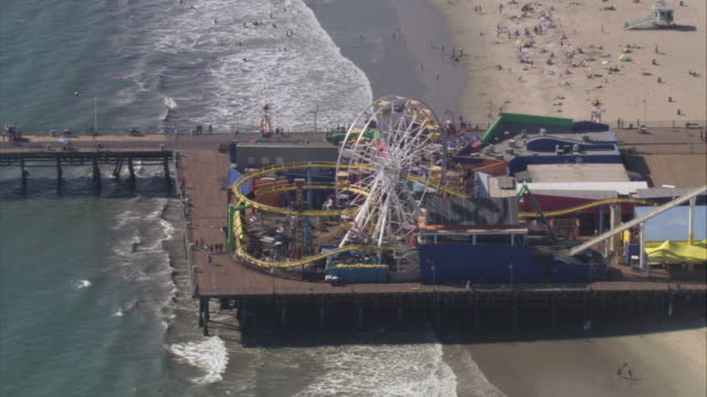 aerial amusement park on the santa monica pier / santa monica, california, united states - santa monica pier stock videos & royalty-free footage