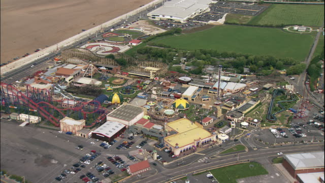 amusement park rides fill pleasureland in southport. - southport england stock videos & royalty-free footage