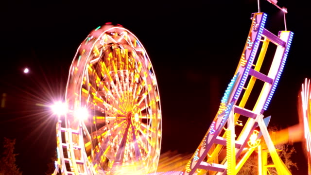 timelapse: amusement park - fairground ride stock videos & royalty-free footage