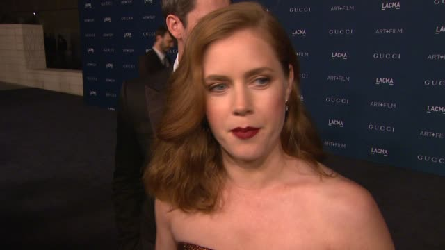 vídeos de stock, filmes e b-roll de amy adams on why she wanted to support lacma and the honorees, her favorite works from sorcese and looking forward to sting's performance at lacma... - 2013