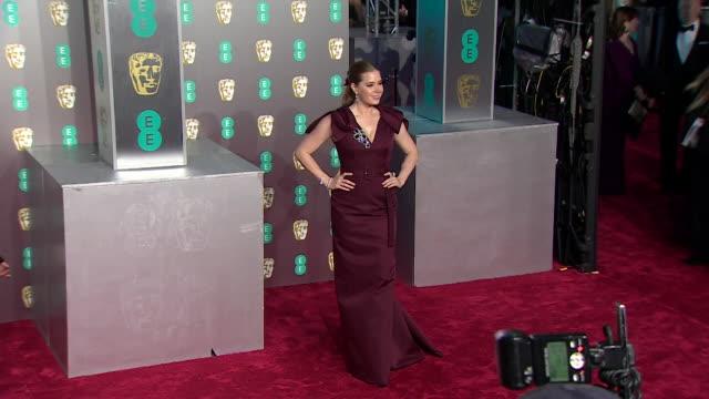 Amy Adams posing for photos on red carpet at BAFTA Film Awards at Royal Albert Hall