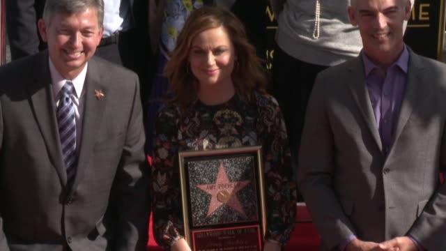 amy poehler and rashida jones at amy poehler honored with star on the hollywood walk of fame at hollywood walk of fame on december 03, 2015 in... - エイミー・ポーラー点の映像素材/bロール