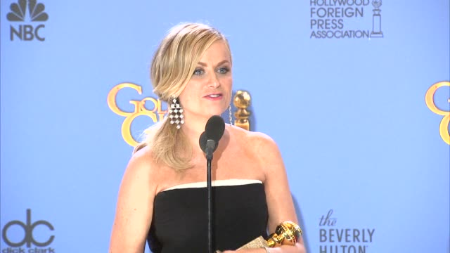 amy poehler at the 71st annual golden globe awards - press room at the beverly hilton hotel on in beverly hills, california. - エイミー・ポーラー点の映像素材/bロール