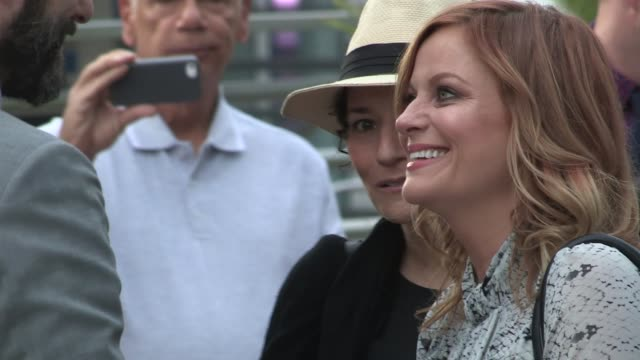 amy poehler norman lear arrive at the adult beginners premiere in hollywood in celebrity sightings in los angeles - norman lear stock videos and b-roll footage