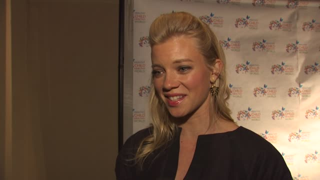 Amy Smart on what she's wearing what she appreciates about the organization the turning point in becoming environmentally conscious if she brings her...