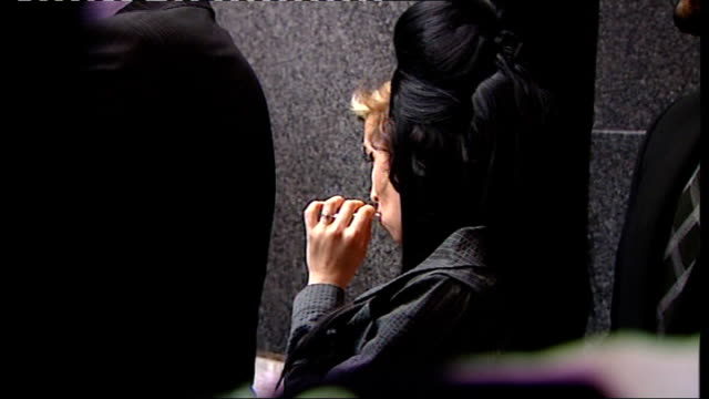 amy winehouse alleged assault trial: cigarette break; england: london: westminster magistrate's court: ext amy winehouse taking 'cigarette break'... - amy winehouse stock-videos und b-roll-filmmaterial
